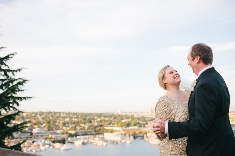 Bride and groom dancing at Canlis with view of Seattle
