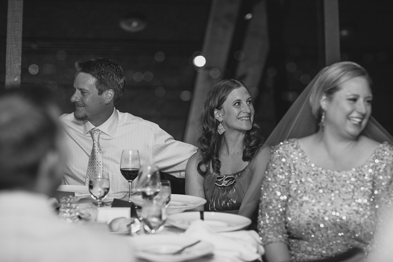 Wedding guest listening to toast at Canlis in Seattle