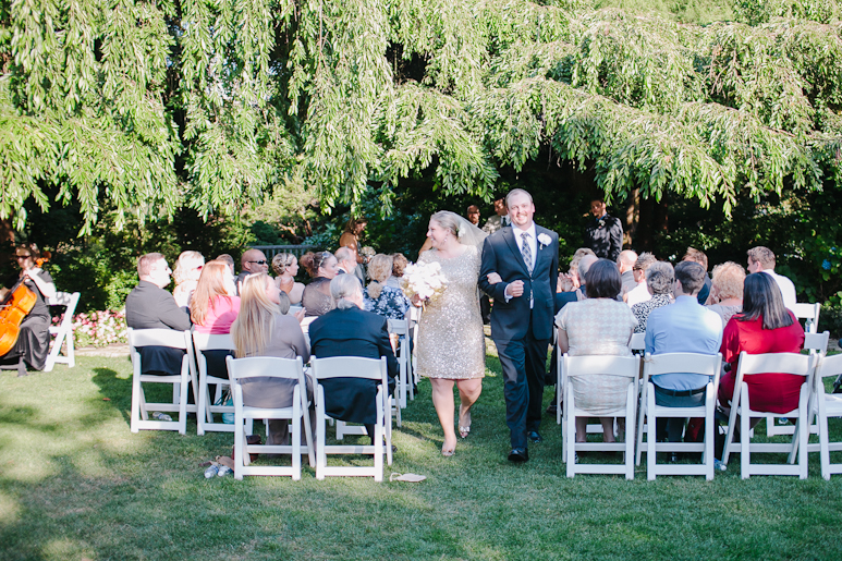 Bride and groom after wedding ceremony at Parson's Garden in Seattle